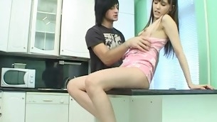 Adorable brunette hair performs non-stop dick-riding in the kitchen