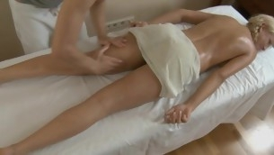 Belle gets her shaved twat ravished by masseur